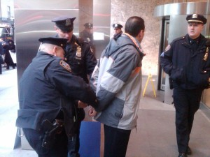 Cabrera was handcuffed by police and arrested after repeated warning to move from the entrance to 100 Church St. where he and six other pastors were protesting. (Photo courtesy Cabrera's office)