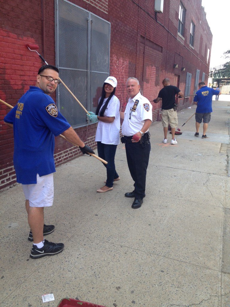 Members of the 52nd Precinct take to the streets to clean up graffiti crime. Photo courtesy 52nd Precinct