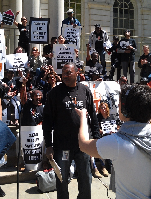TERRELL JONES (center) of New York Harm Reduction Educators at a City Hall rally calling on the public to understand the syringe exchange program.  Photo courtesy New York Harm Reduction Educators