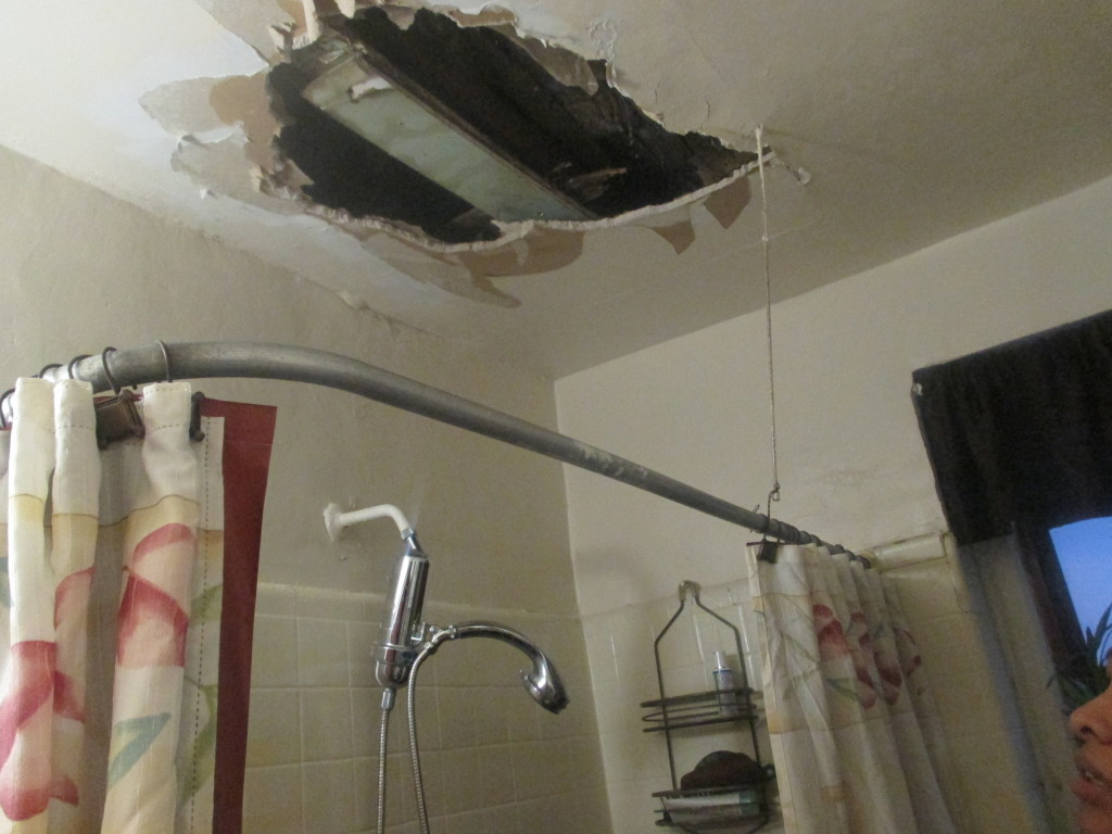 A GAPING HOLE rests above the bathroom of tenant on Creston Avenue. Photo by Jasmine Gomez