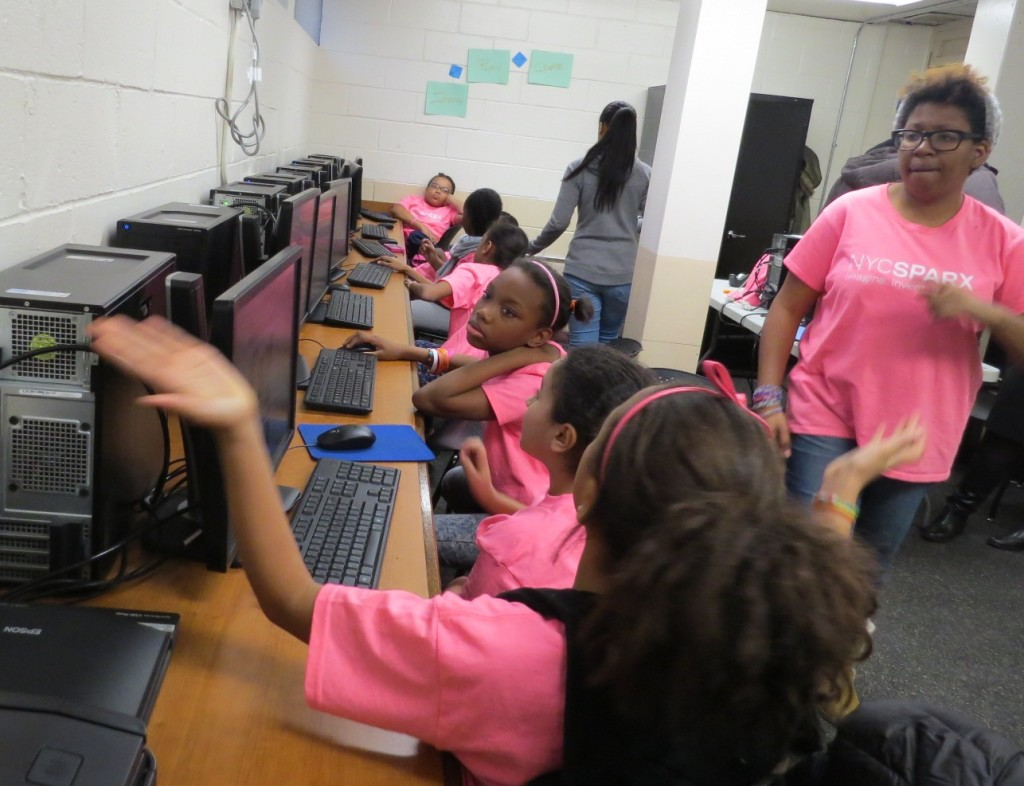 LAIRA REID LEADS a class of young girls at the SPARX program at St. James Recreation Center.  Photo by Jasmine Gomez