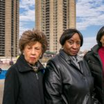 SEEKING ANSWERS. (l-r) Delores Edwards, Jean Hill, and Evelyn McDonald, members of the Tracey Towers Tenants Association support a request for a three-year renovation project of Tracey Towers (background).  Photo by Adi Talwar