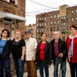 Preserving Bedford Park (Caption) - 5'2'16 FINAL  STAYING PUT. LONGTIME tenants of at 267 E. 202nd St., including (l-r) Marisol Jimenez, her parents Millie and Adali, Olga Ross, Carlos Ross and Nina Archeval are facing eviction by a developer who intends to erect a taller building as per current zoning rules. Bedford Park neighbors look to have those rules changed.  Photo by Adi Talwar