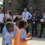 DEBLASIO THE REFEREE. Mayor Bill de Blasio (center) oversees a game of soccer at Millbrook Playground shortly after the announcement. Photo by David Cruz