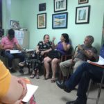 RESIDENTS OF 267 E. 202nd St. hold a tenants association meeting on June 20 at West Bronx Housing.  Photo by David Cruz